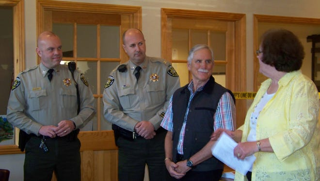 Members of the sheriff's office attended the opening of the satellite station.