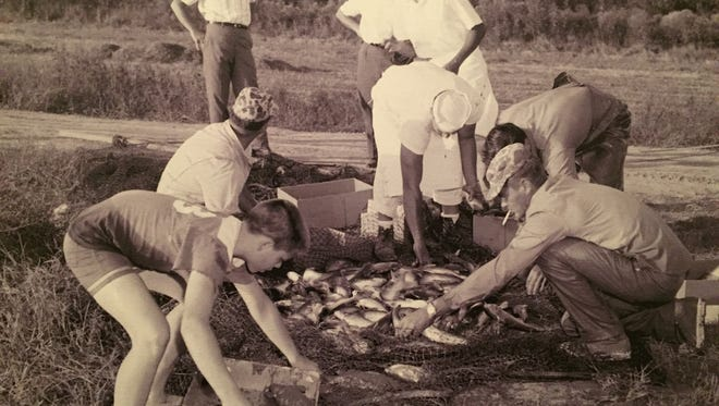 This 1940s photo shows the Landry family sorting through catfish for Don's Seafood and Steakhouse.
