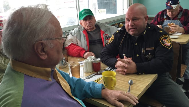 Sandusky County Sheriff Kyle Overmyer hits the campaign trail with a stop for coffee at Gary's Diner in Clyde. Overmyer answered questions from local residents Ron House, near, and Glenn Kistler, seated next to Overmyer.