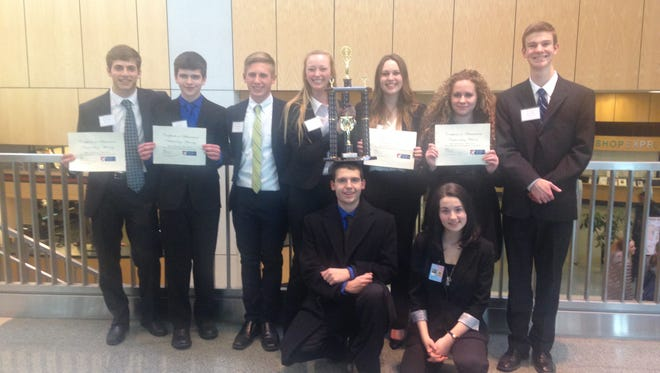 The Lexington High School mock trial team is advancing to Columbus to compete, having won in Akron on Feb. 19. The varsity members pictured in the back row, left to right are: Noah Eckstein, Neil Robinson, Jake Strickler, Annie Olecki, Katie Hunt, Mia Sgambellone, and Casey Martin.  Front row is Spencer Conrad and Jessica Miller.
