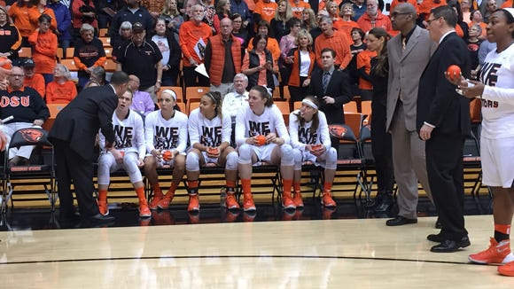 OSU women's basketball coach Scott Rueck (left) gives the starting lineup, from left, Jamie Weisner, Gabby Hanson, Deven Hunter, Ruth Hamblin and Sydney Wiese, instructions before tipoff for the UCLA game Feb. 21 at Gill Coliseum.