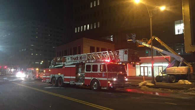 Rochester firefighters on scene at a kitchen fire at Tower 280 in downtown Rochester on Tuesday night.
