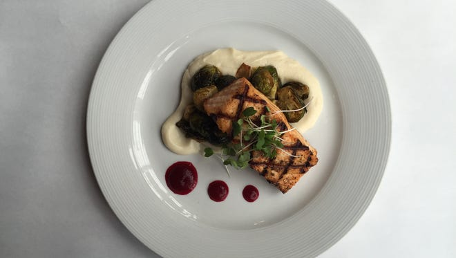 Harvest's grilled salmon with cauliflower puree and beet reduction