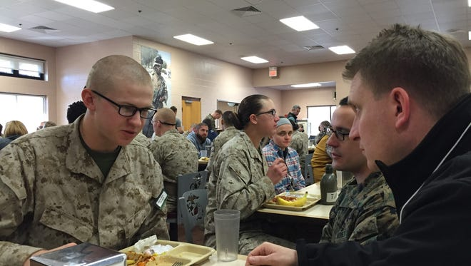 Red Lion Area High School graduate Nate Olsen, left,  talks with Scott D'Orazio, assistant principal of the Red Lion high school, in the mess hall during a Marine Corps Educator's Workshop in South Carolina.