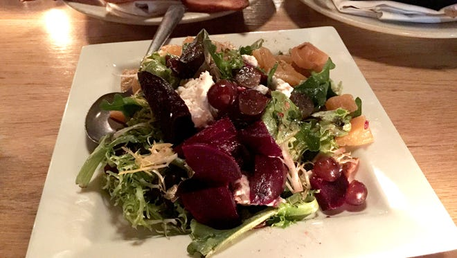 The Roasted Beet Salad marries red grapes and beets over a bed of field greens. Crumbled feta balances the sweet arrangement.