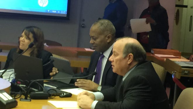Detroit Mayor Mike Duggan and Chief Financial Officer John Hill speak before the Detroit City Council on Thursday, Feb. 25, 2016.