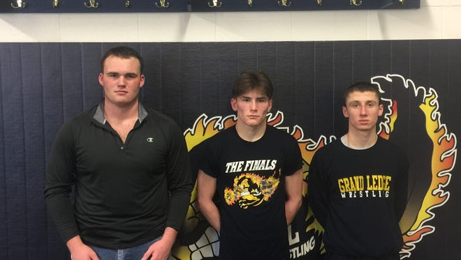 Grand Ledge wrestlers Matt Lloyd (left), Dylan Steward (middle) and Jack Snauko (right) are looking to lead teh Comets to their first state wrestling title in school history.