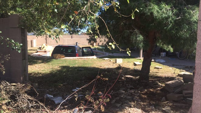 A woman drove through a brick wall into a residential swimming pool near 28th Street and Shea Boulevard on Feb. 25, 2016. She was extricated safely by a Phoenix Fire Department crew.