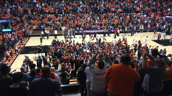 Oregon State players celebrate with fans after an 82-81 victory over Washington State at Gill Coliseum on Feb. 24, 2016.