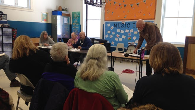 Isle La Motte Selectboard Chairman Steve Stata speaks as residents gather for the annual town meeting on Feb. 28, 2015.