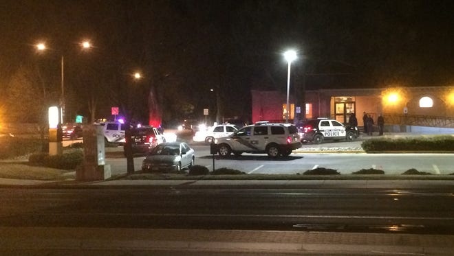 Police cars surround the Taco Bell at College Avenue and Prospect Road on Thursday night.