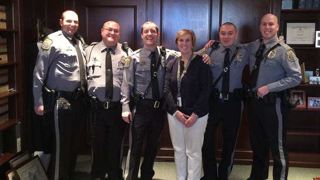 Bonnie Muir Milligan, center, a secretary at the Ocean County Courthouse, with the Ocean County Sheriff's Officers who saved her life on Oct. 16. From left to right, they are: Carl Wydrzynski, Chuck Solimine, Matthew Horton, Michael Baldasar and Daniel Umlauf.