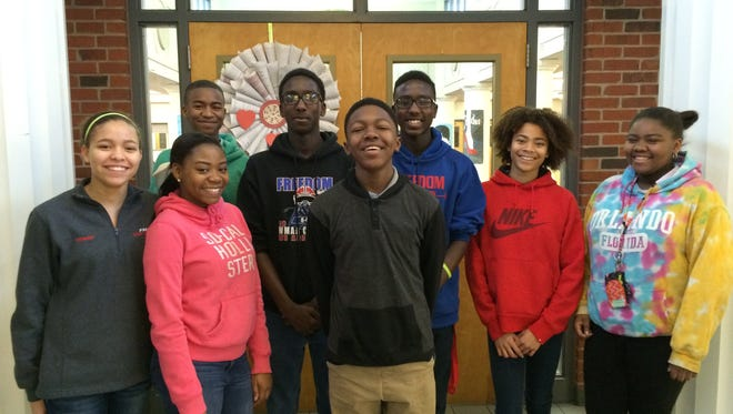 Eighth-grade student nominees for the Freedom Middle School Booker Award from front left to right, front: Taylor Henry, A'Lona Hardeman, Isaiah Tucker, Jadyn Stewart, and Jamaria Smith. Back: Ray'Darrius Hayden, Solathus Johnson, and Savion Johnson.
