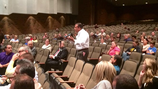 A Gilbert parent speaks at a public hearing discussing options for rehousing Gilbert Classical Academy on Feb. 24.