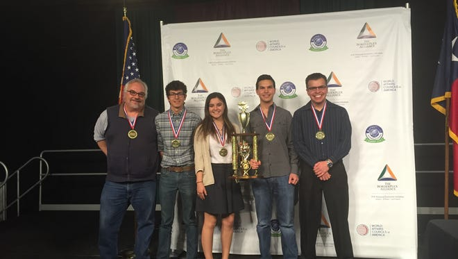 Franklin High School social studies teacher and competition coach James Barton, from left, seniors Roberto Preza, Sophia Gonzalez-Mayagoitia,  David Zehden and Matt Maldonado pose Saturday after the team won the inaugural Borderplex Academic WorldQuest competition.