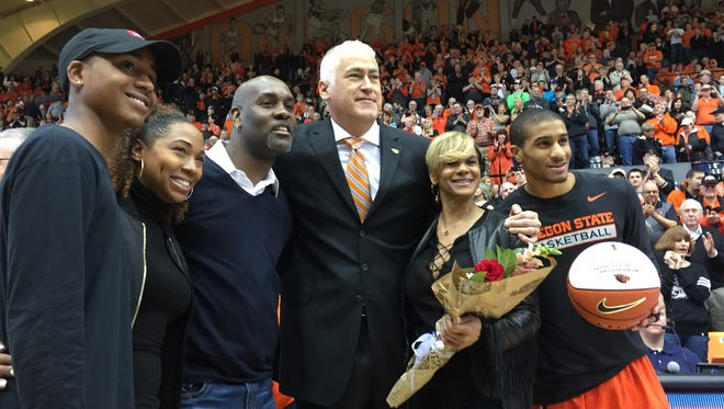 Oregon State senior Gary Payton II (far right), next to his mom, Monique, OSU coach Wayne Tinkle (center) and Gary's dad, Gary (third from left), during Senior Day activities at Gill Coliseum on Feb. 28, 2016