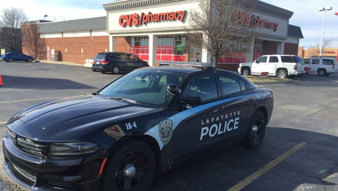 A police car ouside the CVS pharmacy on Indiana 26 in front of Target.