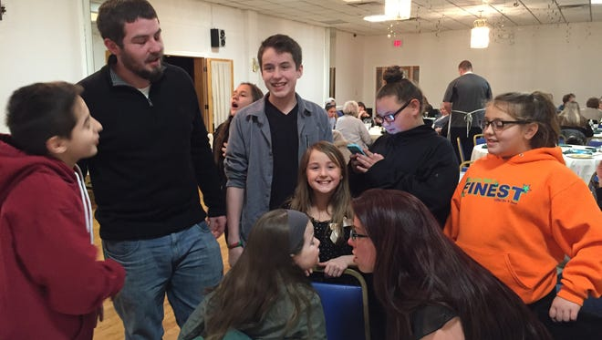 The Czeslaw siblings at the Long Branch Elks Lodge on Feb. 26. The siblings lost both parents to cancer.