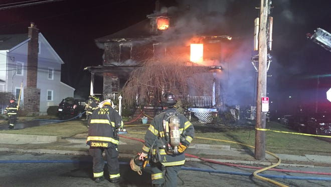 Firefighters battling a a house blaze in Mamaroneck Village early Monday morning.