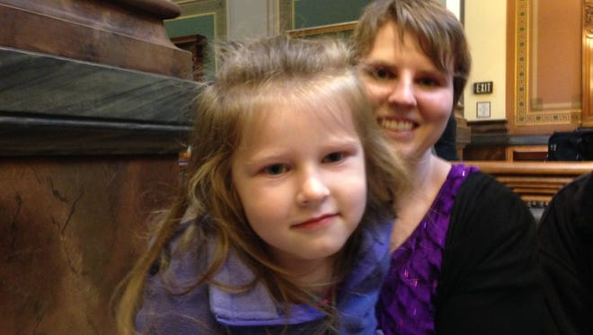 Kaitlyn Haakenson, 4, and her mother, Felicia, went to the Statehouse last week to lobby legislators for a broader medical marijuana bill. Haakenson and her husband, Mike, of Davenport, purchase cannabis oil from a California company and give it to Kaitlyn, who has epilepsy. They say it has reined in her seizures, and helped improve her speech and physical movements.