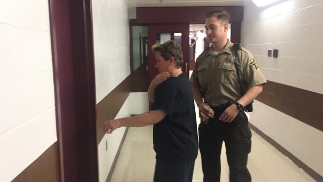 Fired school bus driver Tracy Jo Konsdorf is escorted to a courtroom in the jail.