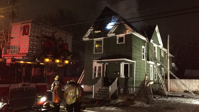 Rochester firefighters on scene at a house fire at 183 Otis Street on Wednesday night.