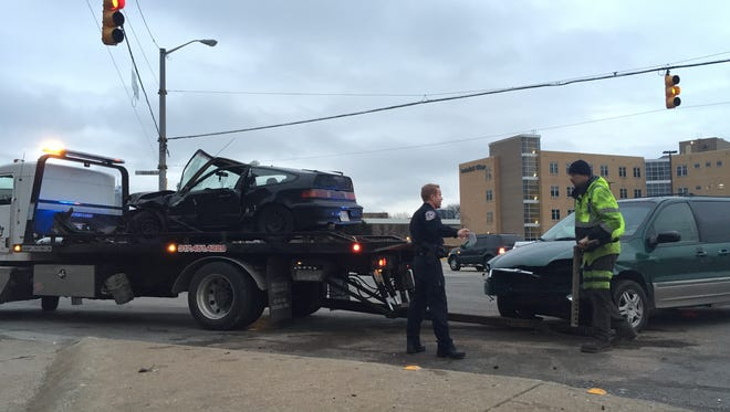Vehicles involved in a wreck Downtown are prepared to be towed away.