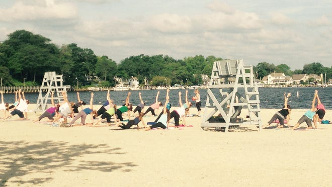 Yoga on the beach helped Beachwood become one of two New Jersey Healthy Towns.