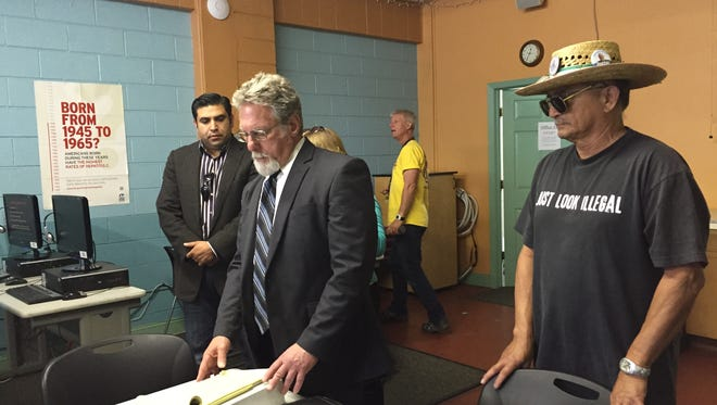 Left, District 1 Councilman Jose Castanada watches Attorney Anthony Prince, as Prince updates reporters at a March 2 press conference.