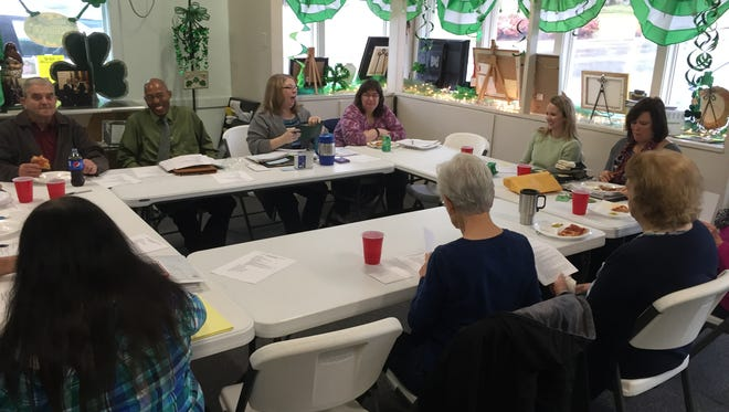 The Houston County Area Chamber of Commerce discusses Irish Day during a meeting at the Chamber office.