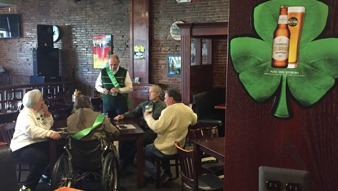 Irish American Club members and CelticFest kickoff attendees converse Friday, March 4, 2016, at Lynch's Irish Tavern.
