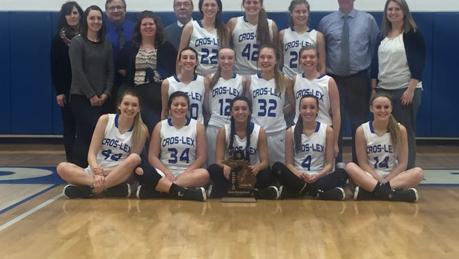 The Croswell-Lexington girls basketball team claimed it's sixth straight district championship Friday against Imlay City. The Pioneers defeated the Spartans, 59-41