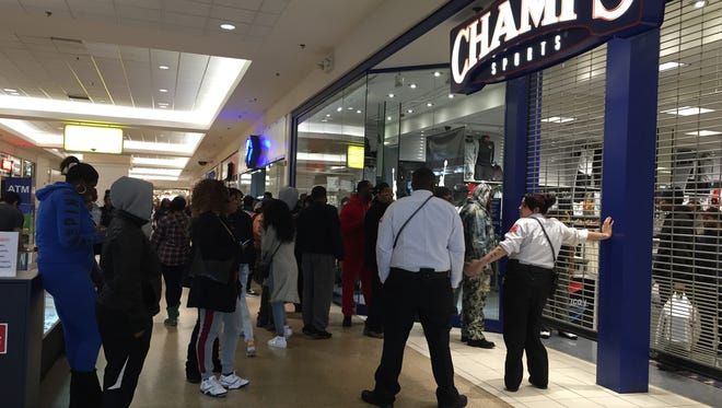 The line in front of Champs Sports at Eastland Center Mall in Harper Woods.