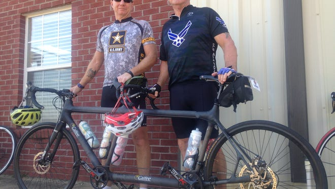 Thomas Schwerin, left and Larry Gunter, right ride with Ride 2 Recovery's Gulf Coast Challenge to help disabled veterans like themselves.