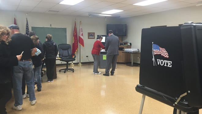Marine City voters cast their ballot at the city's fire hall on Tuesday, March 8, 2016. A public safety special assessment tax was on the ballot.