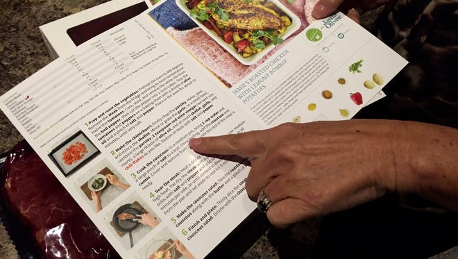 Kim Golonka, of Marlton, looks over the instructions for Chimichurri Steak, a meal kit delivered from Hello Fresh.