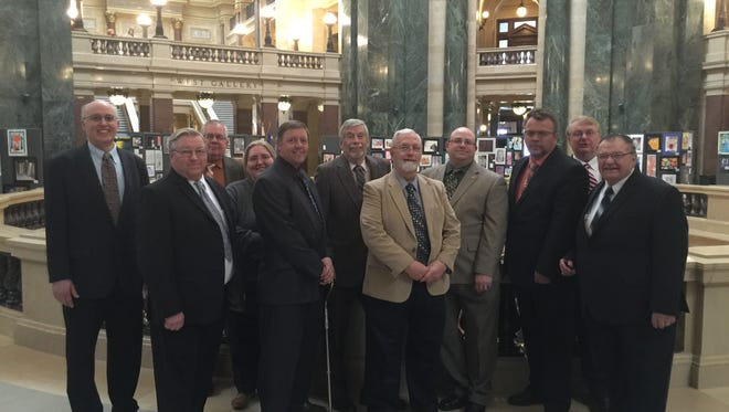 A group from the Wisconsin Apartment Association in the Capitol on Feb. 29, 2016, when Gov. Scott Walker signed a bill that effectively ended municipal rental licensing programs. John Fischer is the fourth person from the right.