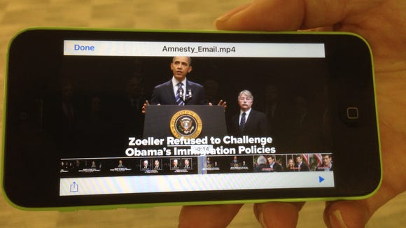 An image from an ad attacking Attorney General Greg Zoeller in the 9th Congressional District race.