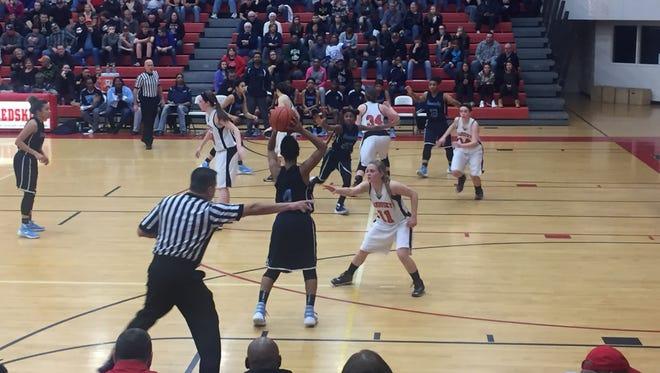 Sandusky High School defends Flint Hamady Thursday night during its 46-36 Class C regional final loss