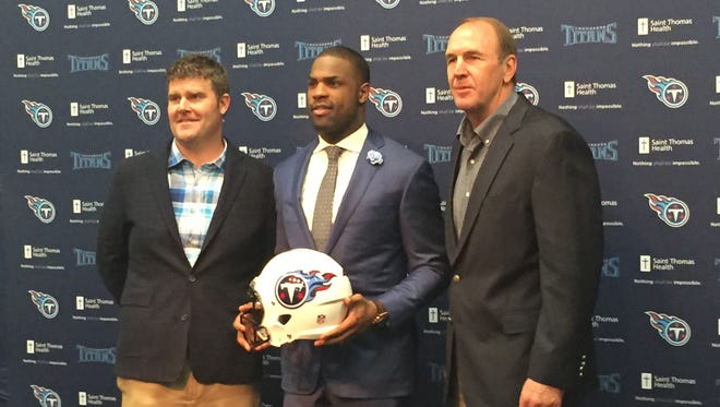 Running back DeMarco Murray is introduced by Titans general manager Jon Robinson and coach Mike Mularkey during a press conference Thursday at St. Thomas Sports Park.