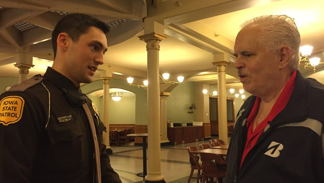 On Friday, March 11, 2016, Iowa State Patrol Trooper Joe Long meets Craig Vance, whom he helped save after Vance suffered a heart attack Feb. 18, 2016, at the Capitol in Des Moines.
