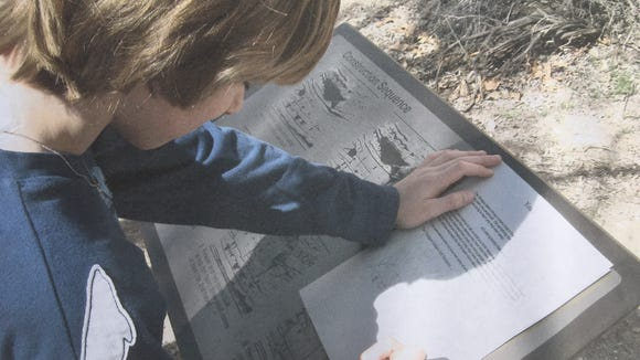 Sawyer takes notes along the trail that meanders around