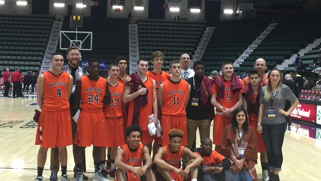 The Marlboro High School boys basketball team poses after winning a New York State Class B semifinal game against Bishop Grimes.
