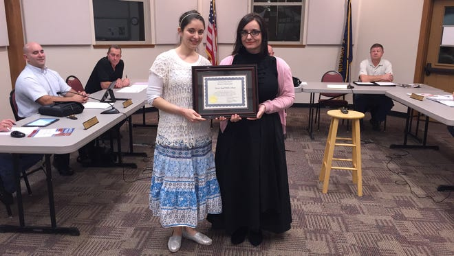 Mt. Angel Library director Carrie Alexandria Caster and youth services librarian Stephanie Laing received the award before the City Council on March 7.