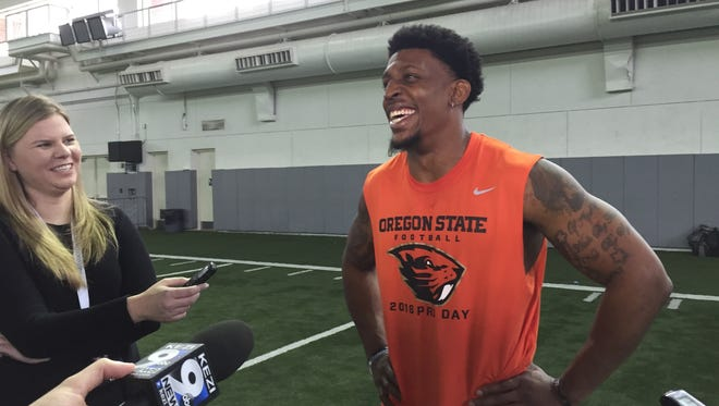 Former Oregon State running back Storm Barrs-Woods meets with the media after pro day, March  11, 2016.