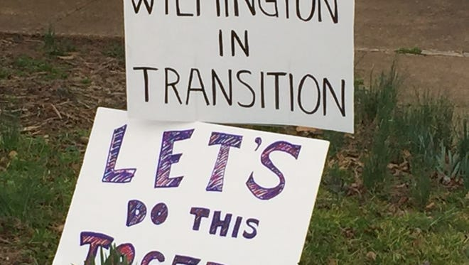Signs displayed at a Wilmington Peace Rally Thursday night.
