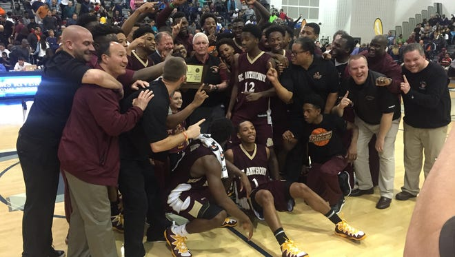 The St. Anthony boys basketball team celebrates winning the NJSIAA Non-Public B State title on March 12, 2016 at the Pine Belt Arena in Toms River