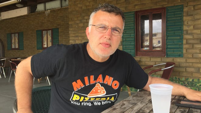 Adam Bardhi, the owner of Milano Pizzeria, is worried about the impact the removal of 1,500 state workers from  Northwood Centre would have on his business.