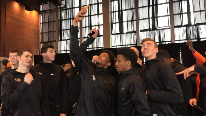 Oregon State players celebrate their bid to the NCAA tournament during a Selection Sunday Watch Party at the Club Level of Reser Stadium.