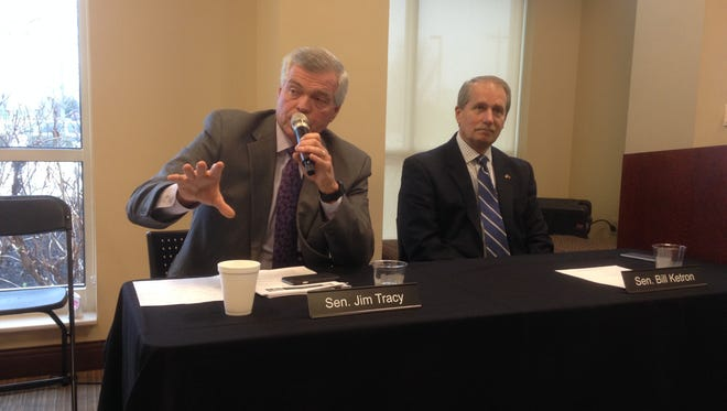 State Sen. Jim Tracy, R-Shelbyville, left, responds to questions about the Tennessee gas tax by saying the Tennessee Department of Transportation is studying the needs and how to fund projects.